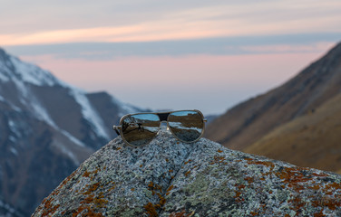 reflection of mountains in sunglasses