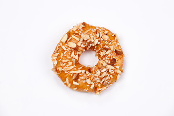 Delicious donut with almond caramel glazed, Isolated on white background.