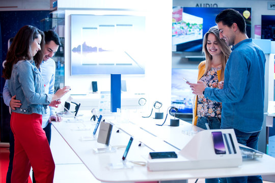 young people shopping for latest phone