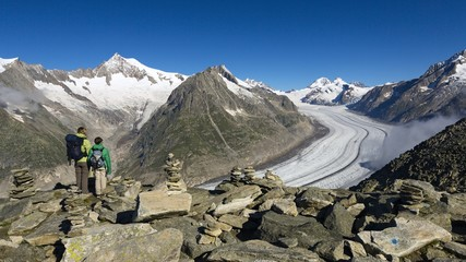 Tourists looking Aletsch glacier and Jungfrau peaks, Fiesch, Canton of Valais, Switzerland