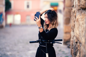 Attractive woman taking selfies with phone camera. Portrait of cheerful girl smiling and taking photographs