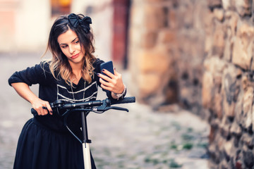 Lifestyle details - portrait of woman taking selfie with smartphone, relaxing on electric scooter