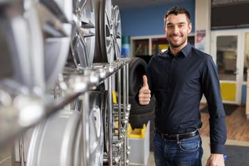 male customer choosing wheel rims at car service