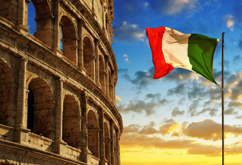 Italian flag with Flavian Amphitheatre or Colosseum at sunset. Rome, Italy