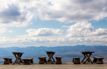 Wooden benches and tables in the mountains