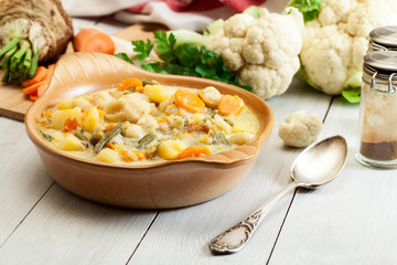 Vegetable soup with ingredients carrot, cauliflower, potato and