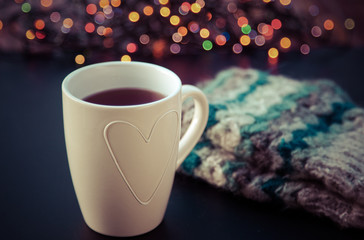 hot tea in white cup and Christmas decorations - cozy winter day