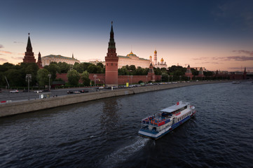 Motor ship on Moscow river and beautiful Kremlin in the evening