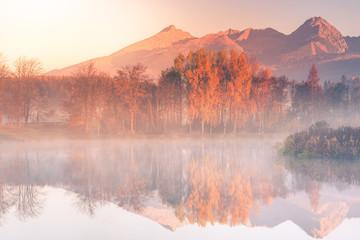 Fotobehang Alpen Sunrise light hits high mountains peaks in Tatra mountains