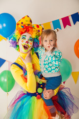 Wall Murals Rainbow clown girl and little baby. Celebration. Birthday