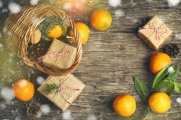 Festive Christmas Basket with gift boxes and tangerines