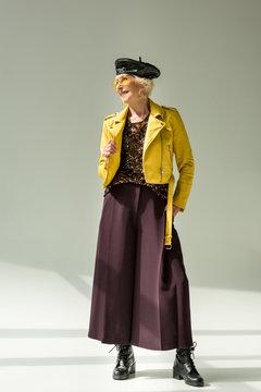 senior lady in yellow leather jacket