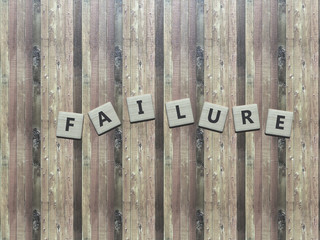 Failure - wooden scrabbles on a table - word - 3d render