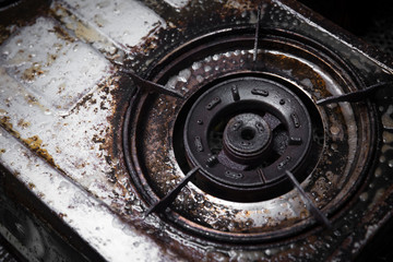 dirty gas stove grunge with oil grease black burn stain old unclean need to scrub