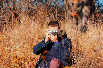 guy takes pictures on a retro camera