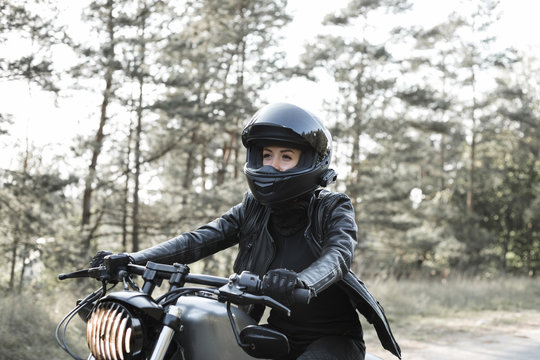 Young woman driving motorcycle
