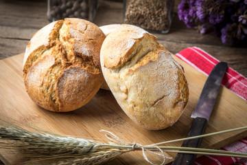 Roll breads on cutting board.
