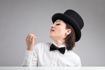 vain woman in top hat showing herself off