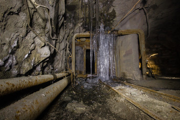 Underground abandoned ore mine shaft tunnel gallery with ice