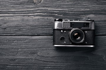 Camera retro. On a wooden surface. Top view. Free space for your text.
