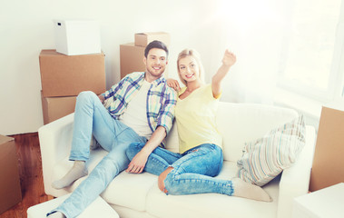 couple with boxes moving to new home and dreaming