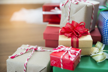 Gift boxes from santa with ribbon on wooden table,colorful present for Birthday,Christmas and Happy New Year Party.Gift wrapping with recycle,craft,green,red,blue and brown paper with beautiful bow.