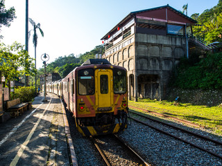 The old taiwanese train style for tourist to have some sight seeing moment of the nature toward Shifen waterfall. The moment is really nice, the vintage train with sunlight and shade on the railway