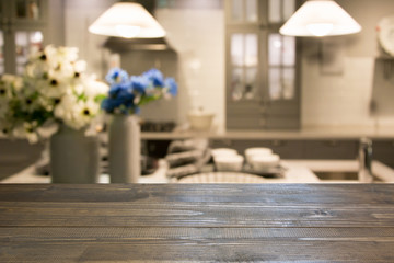 Blurred kitchen background. Modern kitchen with tabletop and space for you.