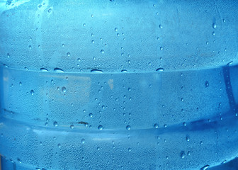 thwtexture of the water drop in a blue translucent plastic tank