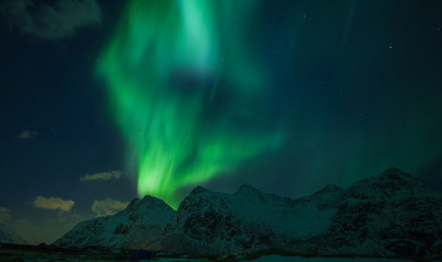 Northern lights (Aurora borealis) over the mountains. Norway, Lofoten