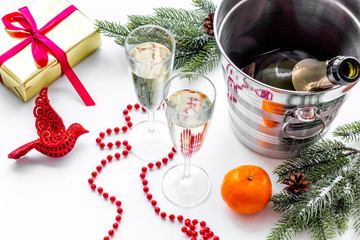 New Year 2018 background. Champagne in bucket, glasses with beverage, spruce branch and decoration on white background