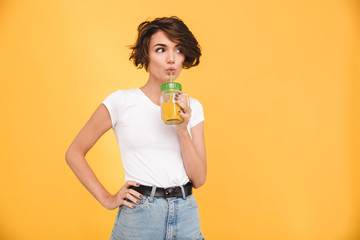 Poster Sap Portrait of a cute casual girl drinking orange juice