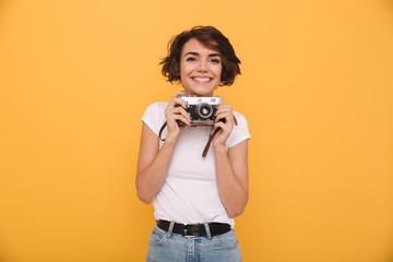 Portrait of a smiling cute girl retro camera