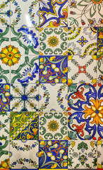 Detail of the traditional decorative tiles with majolica patterns.