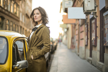 Beautiful woman standing in the street