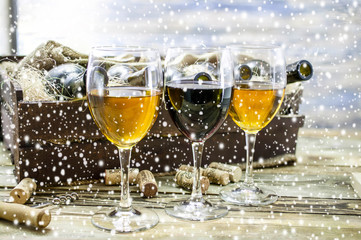 Three wine glasses. Red and white wine. New Year celebration background.