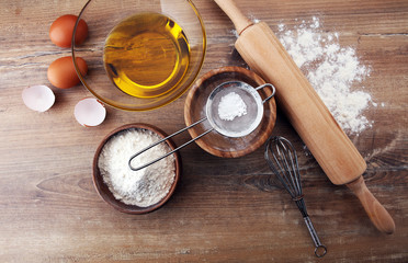 Baking ingredients for homemade pastry on wooden background. Bake sweet cookies concept