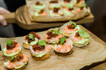 Sandwiches or assorted canapes, top view wooden