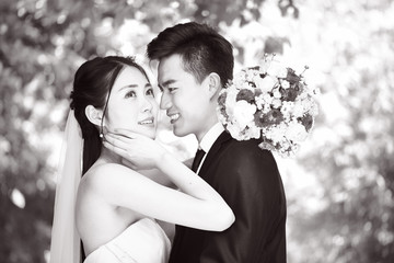 loving asian newly-wed couple