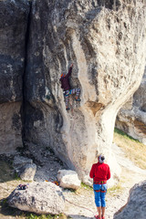 Two climbers are training.