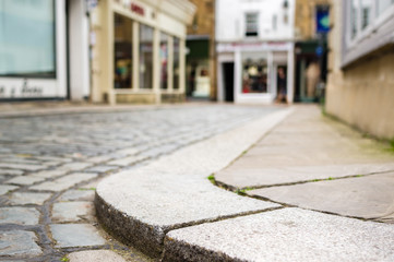 Kerb on cobbled street