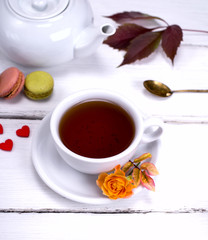 white cup with black tea