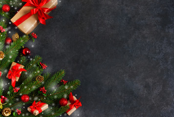 The New Year card is decorated with fir, boxes, ribbons and snow on a black background. Happy New Year and Merry Christmas!