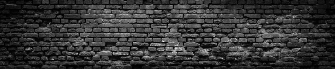 Black Old Brick wall panoramic background in high resolution