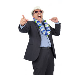 He is wearing suit, Hawaiian necklace and sunglasses. Carnival. Businessman having fun at happy hour..