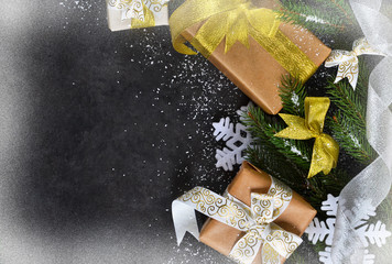 Happy New Year and Merry Christmas. Christmas boxes with gifts with fir on a black background.