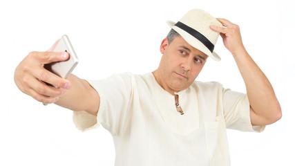 Man is taking a selfie. Traveler is wearing comfortable white hippie robe..
