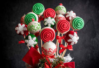 Christmas decoration on the cake pops on dark background,selective focus