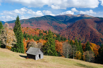 Autumn Landscape with a wooden house in the mountains