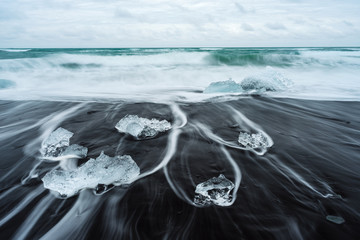 Ice on the beach with black sand in Iceland